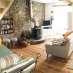 French house rental southern France living room in the stone house in Saint Hilaire complete with log-burner fire if it gets chilly